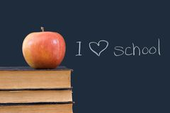 I 'heart' school written on blackboard with apple, Stock Images