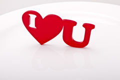 I heart U. Or I love U phrase with a red heart shape on glossy background stock image