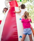 I help you. Three little girl playing together on playground. close up royalty free stock photography
