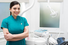 I am here for assist you. Confident female dental assistant posing Stock Photography