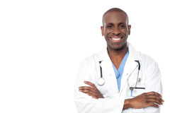 I am here at your assistance. Image of a cheerful middle aged doctor over white Royalty Free Stock Image
