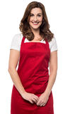 I am here at your service sir !. Pretty mid woman chef posing over white Royalty Free Stock Photography