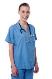 I am here at your service. Young female physician posing over white Royalty Free Stock Photo