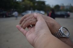 I hold my lovely grandfather`s hand royalty free stock photography