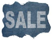 I jeans contrassegnano con la vendita di parola Fotografia Stock Libera da Diritti