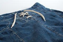 I jeans fiancheggiano con la fine dell'allacciamento su Immagine Stock