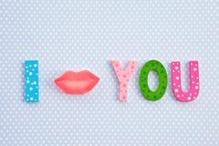 I Kiss you with lip shaped candy. I kiss you written with lip shaped candy Stock Images