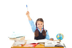 I know the answer!. Schoolgirl at school raising hand with pencil :I know the answer Royalty Free Stock Image