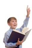 I know the answer. Schoolboy student with arm outstretched ready to give an answer royalty free stock image