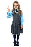 I know the answer. School girl raising hand. Royalty Free Stock Image