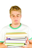 I Know Everything. Young Man carrying a bunch of books Royalty Free Stock Photography