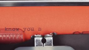 I know you secret - typed on a old vintage typewriter. Printed on red paper. The red paper is inserted into the. Typewriter stock footage