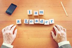 I am a leader. Businessman made text from wooden cubes royalty free stock photography