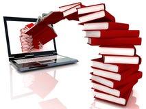 I libri rossi volano nel computer portatile Fotografie Stock