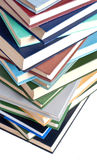I libri torreggiano su isolato su bianco Immagine Stock Libera da Diritti