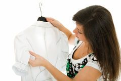 I like it. Young girl views white jacket on white background Stock Images