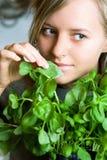 I like basil. Pretty woman smell fresh basil Stock Photos