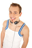 I like listen good music. Smiling handsome young man in casual style with headphones, isolated on white background Royalty Free Stock Image