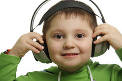 I like this melody. Boy in headphones smiling isolated over white Stock Image