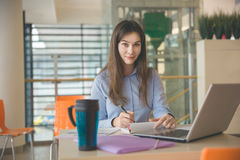 I like my work. Portrait of young pretty woman working remote at cafe Royalty Free Stock Photos