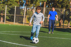 I like playing football with my dad Royalty Free Stock Image