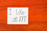 I like - Post it Note on Wood Background Royalty Free Stock Images