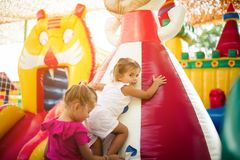I like to help. Two little girl playing together. Space for copy stock photography