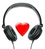 I like to listen to music. Black headphones on a white background, on the middle there is the red heart designating love to music Royalty Free Stock Photography