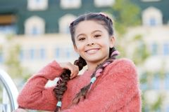 I like to look casual yet chic. Beauty look of small fashion model. Adorable girl with fashionable look on urban royalty free stock images