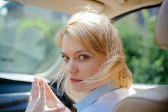 I like traveling. Pretty woman travel by automobile transport. Eco driving is an ecologic driving style. woman. Enjoy road trip. Eco friendly and sustainable royalty free stock photo