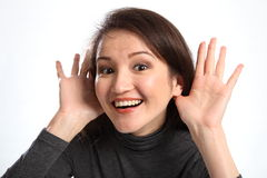 I am listening indicates smiling happy woman Royalty Free Stock Images