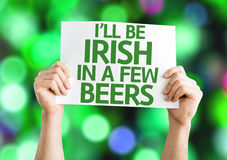 I'll Be Irish in a Few Beers card with colorful background with defocused lights. I'll Be Irish in a Few Beers card with colorful background Stock Photo