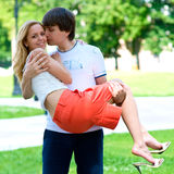 I'll wear you in my arms. The young man picked up a girl in his arms - let it always will be Royalty Free Stock Photo