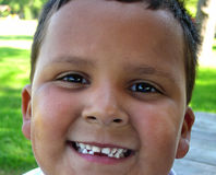 I Lost A Tooth!. Smiling hispanic boy with missing teeth royalty free stock photos