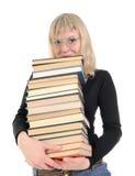 I lotti biondi della holding dei libri Fotografie Stock