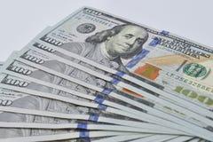 I lotti di cento banconote in dollari Fotografia Stock