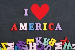 I love America word on black board background composed from colorful abc alphabet block wooden letters, copy space for royalty free stock images
