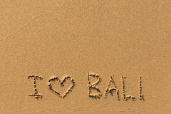 I love Bali - the inscription by hand on the beach sand. Travel. Royalty Free Stock Photo