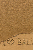 I love Bali - phrase written by hand on the beach with soft waves. Travel. Stock Photos