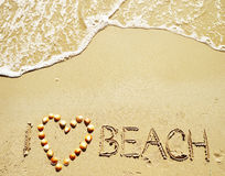 I love beach witten on the sand Royalty Free Stock Images