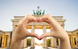I love berlin. Tourist at the brandenburg gate with a heart shaped hand Royalty Free Stock Image