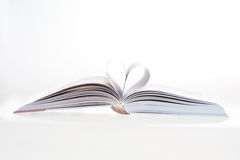 I love books. Detail of open book with heart shape, close-up Royalty Free Stock Photo