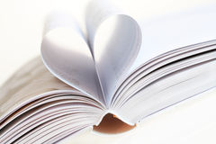 I love books. Detail of open book with heart shape, close-up Stock Image
