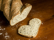 I love Bread. Heart shaped   bread  on  wooden table Royalty Free Stock Image
