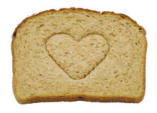 I Love Bread - Isolated. A slice of whole grain wheat bread emblazoned with a loving heart shape Stock Image