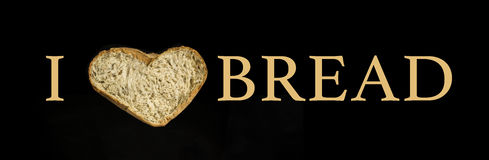 I love Bread. Slice of heart shaped bread Royalty Free Stock Photography