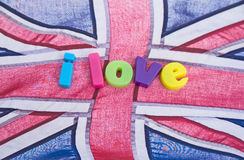 I love Britain: possible logo?. An image of the words, in colorful lower case letters ' I love '  laid upon a British Union Jack flag indicating ' I love Britain Stock Images