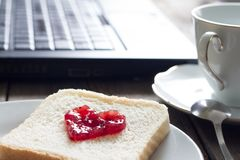 I love business workplace concept with laptop breakfast jam heart shape and coffee. Closeup stock images