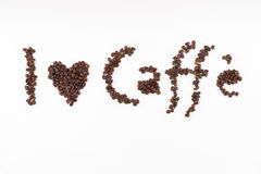 I love caffe. Title made of coffee beans royalty free stock photo
