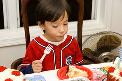 I love cake. Picture of a little boy enjoying a slice of cake Royalty Free Stock Image